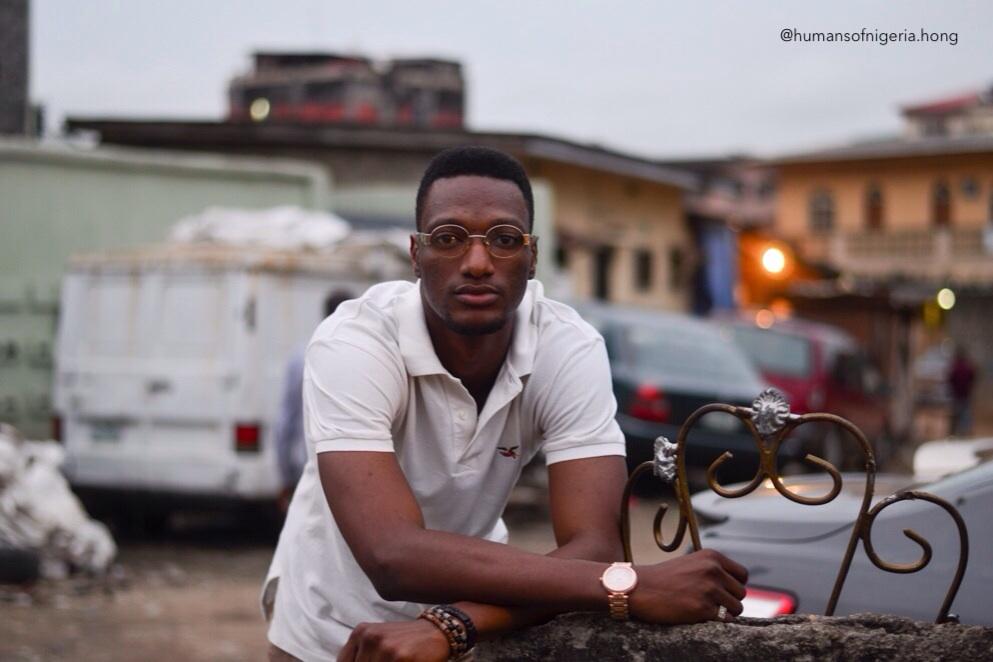 Humans of Nigeria - man posing at a gate